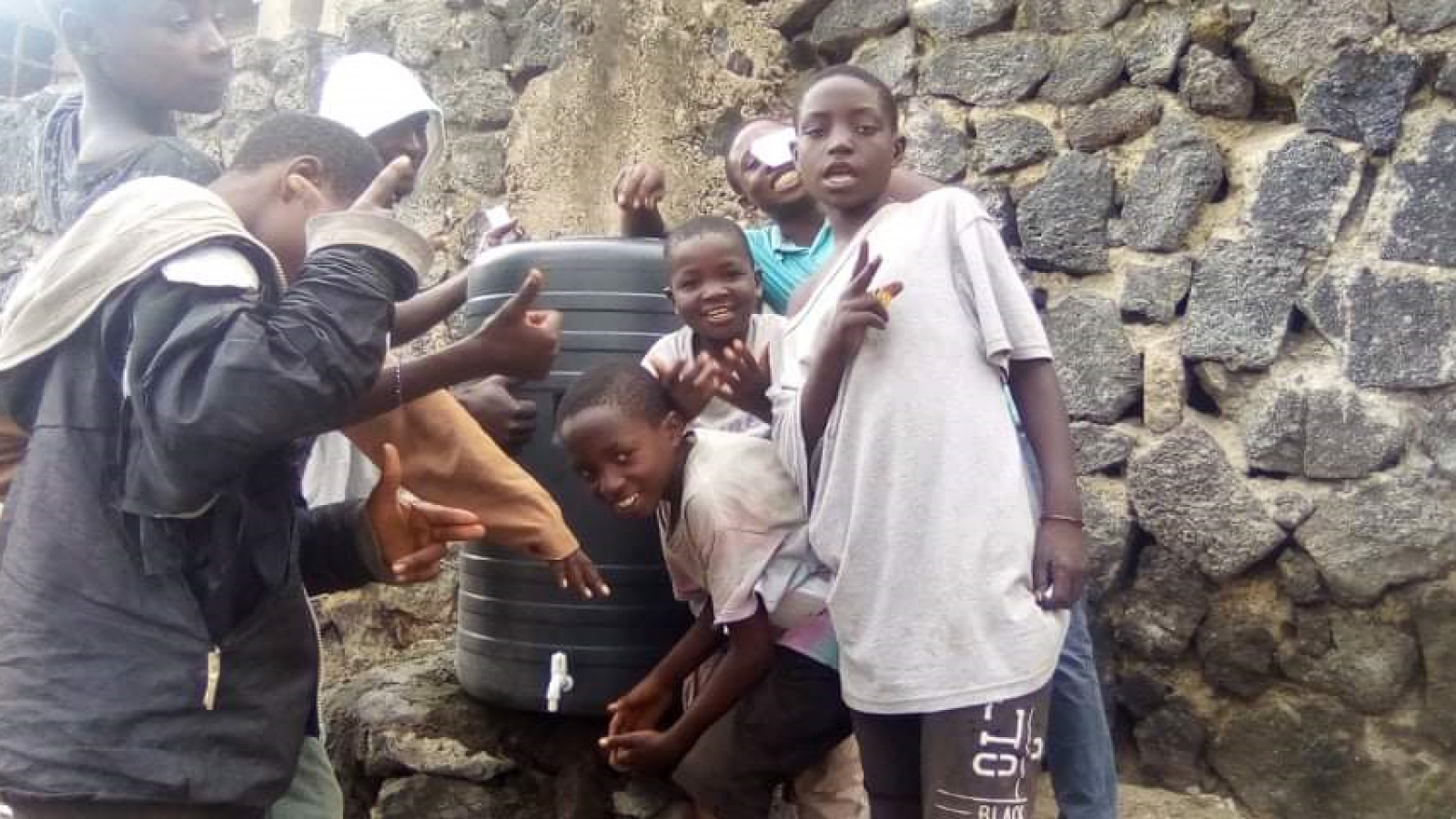 Teenagers with a hand-washing station in Goma DRC